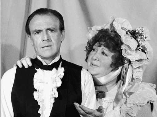 """Richard Bull as Nels Oleson, and his on-screen wife Harriet Oleson on """"Little House on the Prairie""""   Source: Getty Images"""