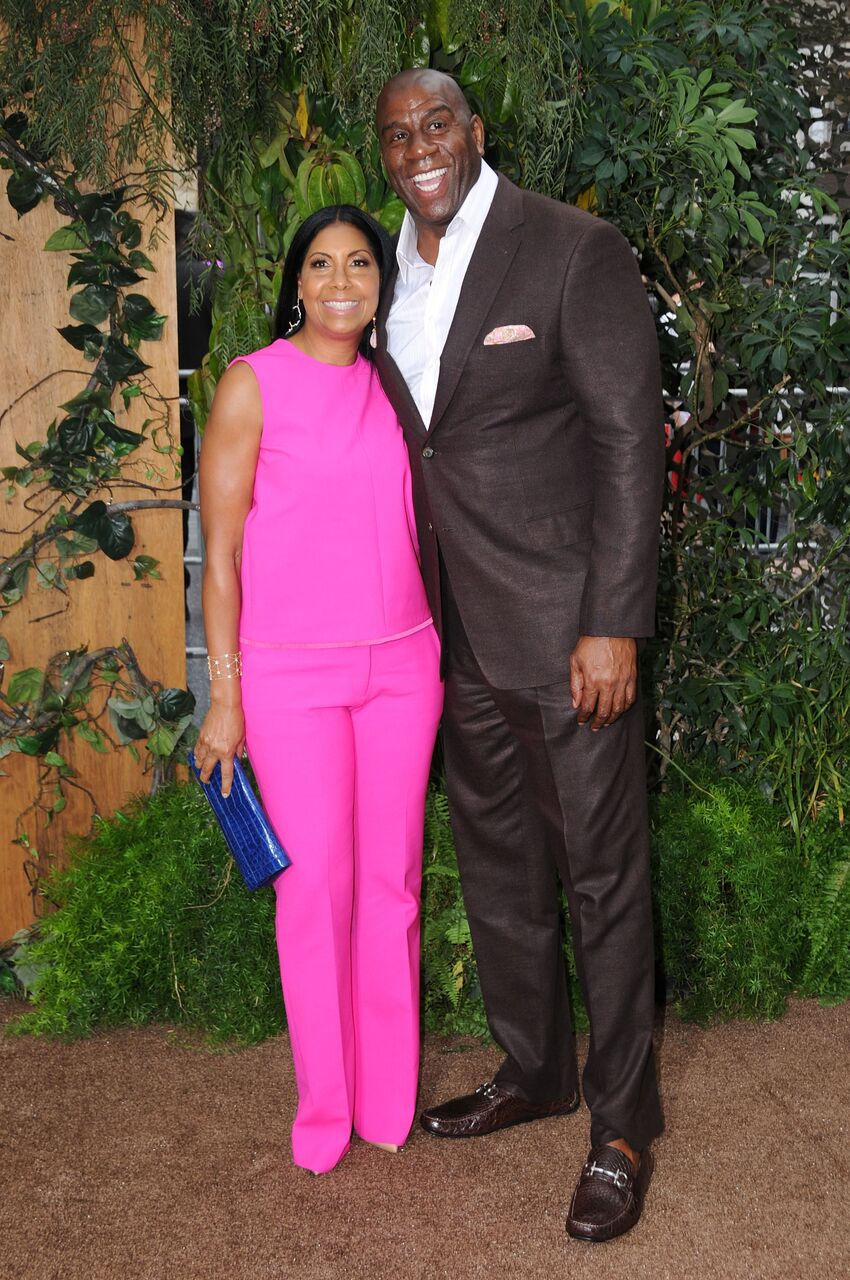 """Cookie Johnson and Magic Johnson at the premiere of Warner Bros. Pictures' """"The Legend Of Tarzan.""""  