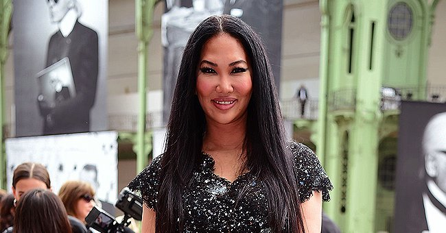 Kimora Lee Simmons Flaunts Slim Legs in Black Baby Phat Hoodie & Knee-High Boots in New Pic