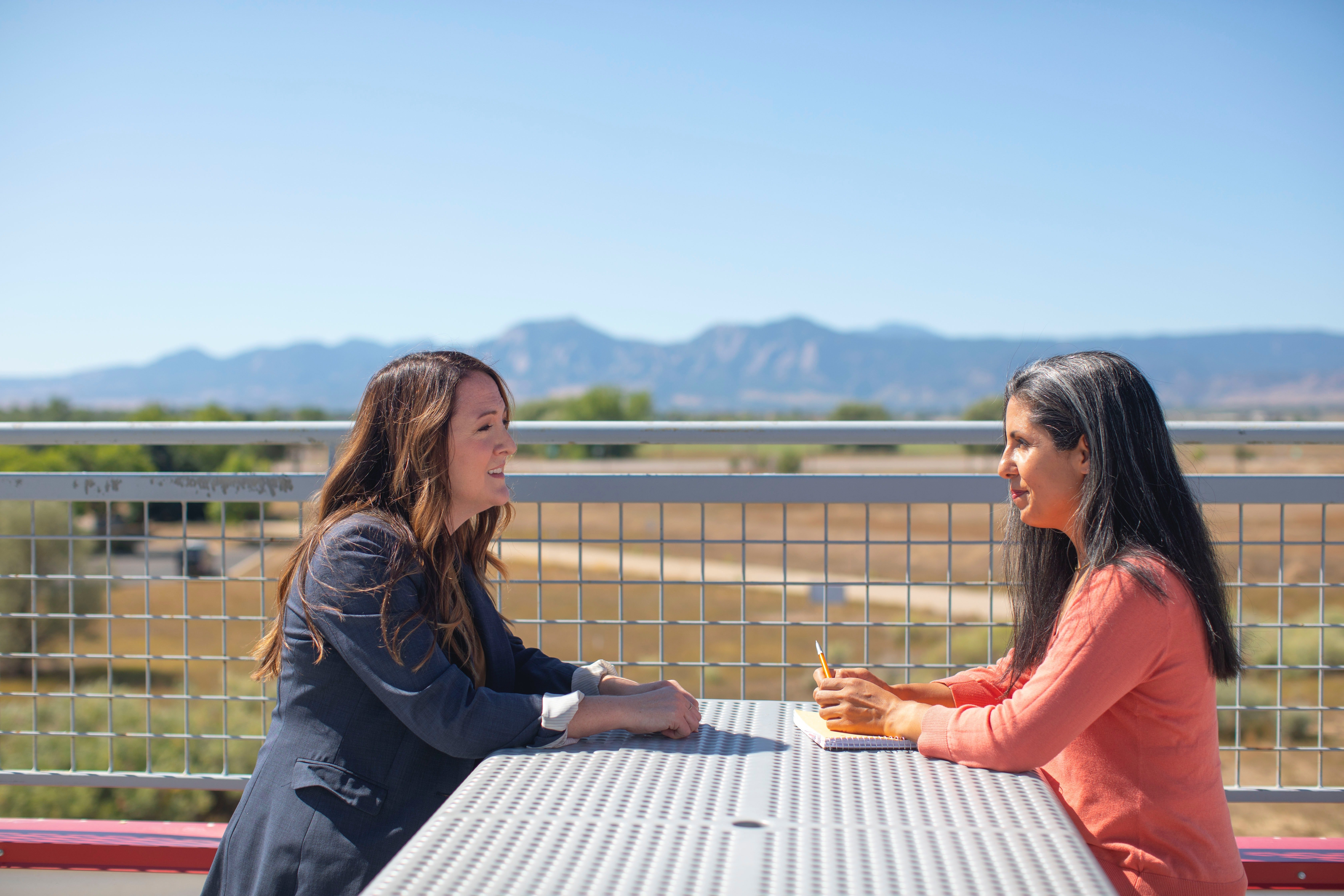 Two women sitting on a bench | Source: Unsplash / LinkedIn Sales Solutions
