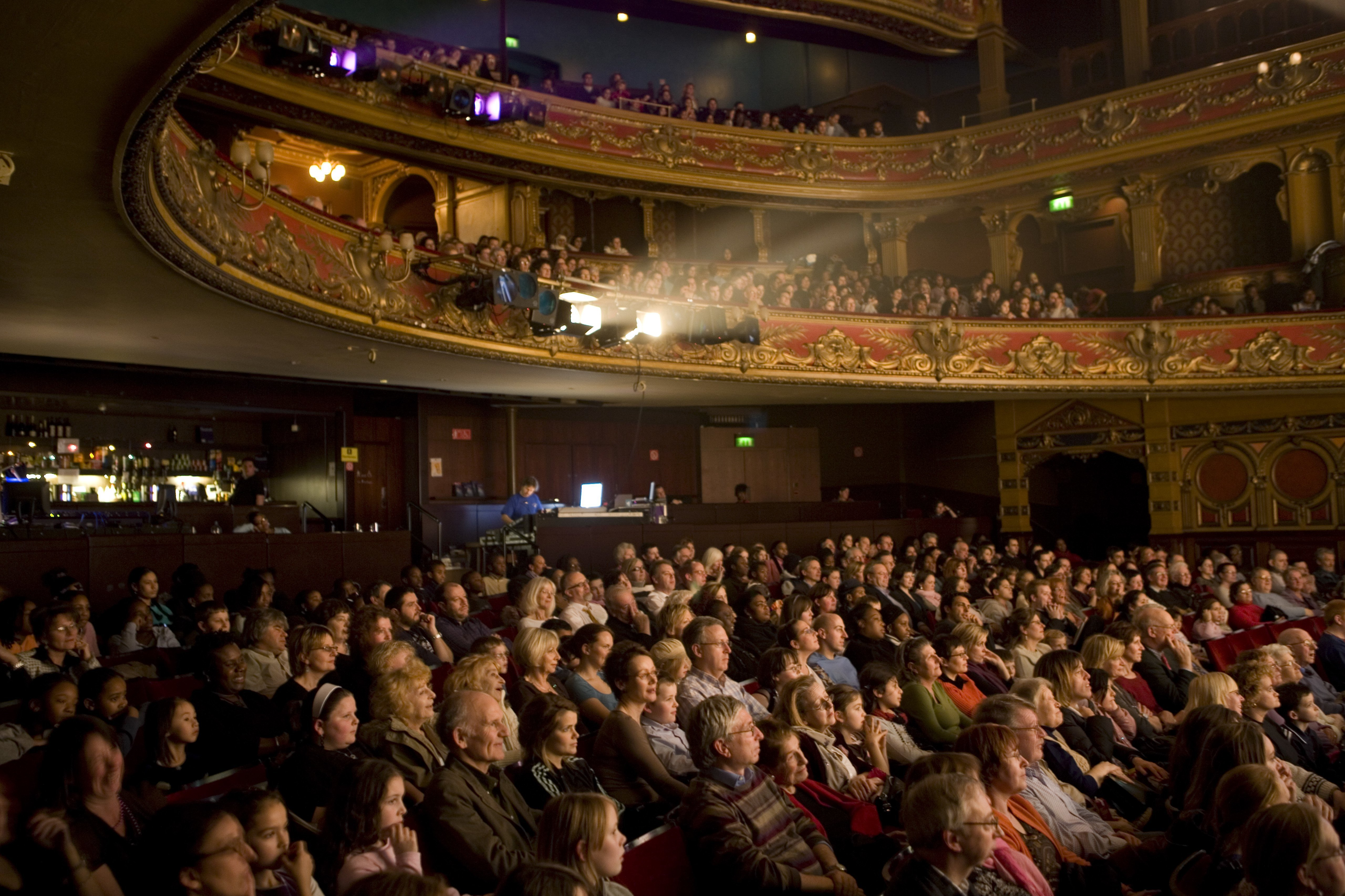 A captivated audience watches a performance at the Hackney Empire Theatre| Photo: Getty Images