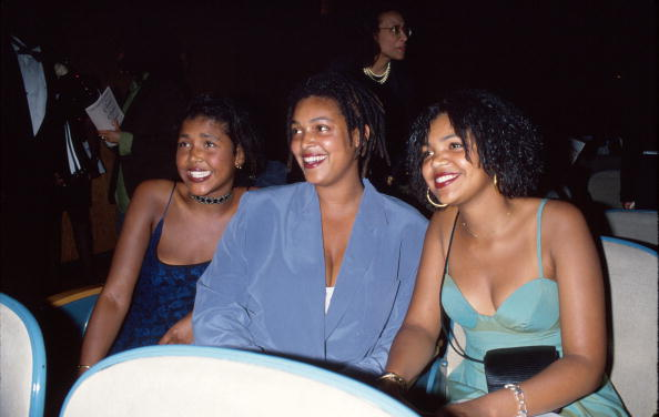 Actor Bill Cosby's daughters Ensa, Erika, and Evin sitting at a table at an event | Photo: Getty Images