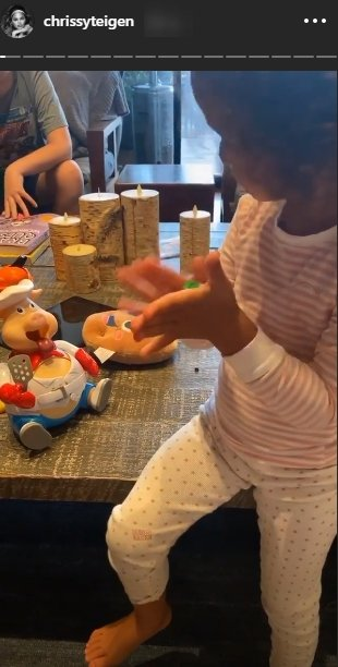 Chrissy Teigen shared a picture of her daughter, Luna Legend playing The Goliath Pop the Pig With Bonus 24pc/Puzzle game |Source: Instagram.com/chrissyteigen