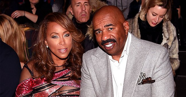 Marjorie and Steve Harvey Raise Fists and Urge Fans to Vote in a Photo