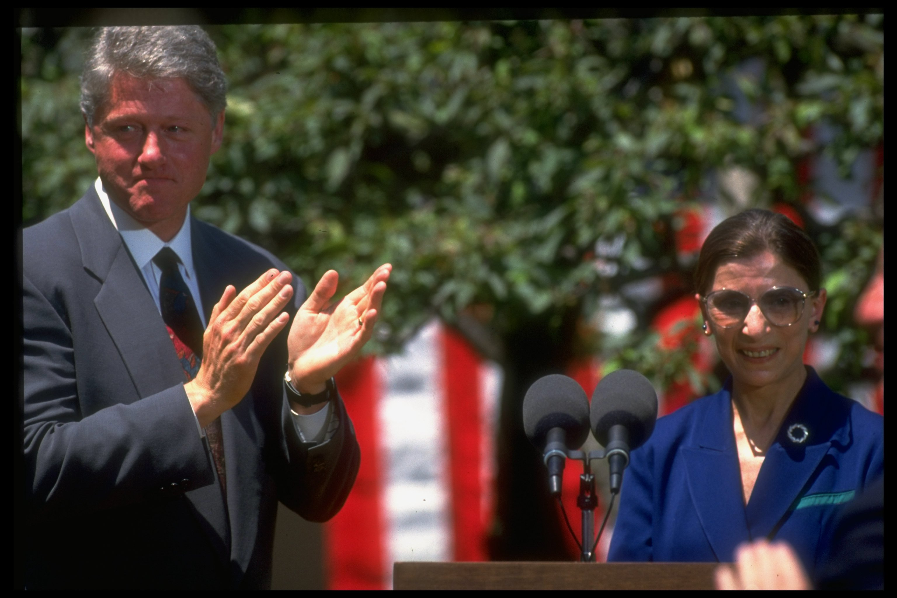 Former United States President Bill Clinton applauding Judge Ruth Bader Ginsburg after Supreme Court nominee's acceptance speech at the White House Rose Garden in Washington D.C. | Photo: Dirck Halstead/The LIFE Images Collection via Getty Images/Getty Images