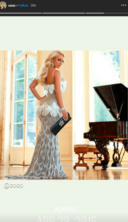 An image of Coco Austin posing in a classic fishtail dress | Photo: Getty Images