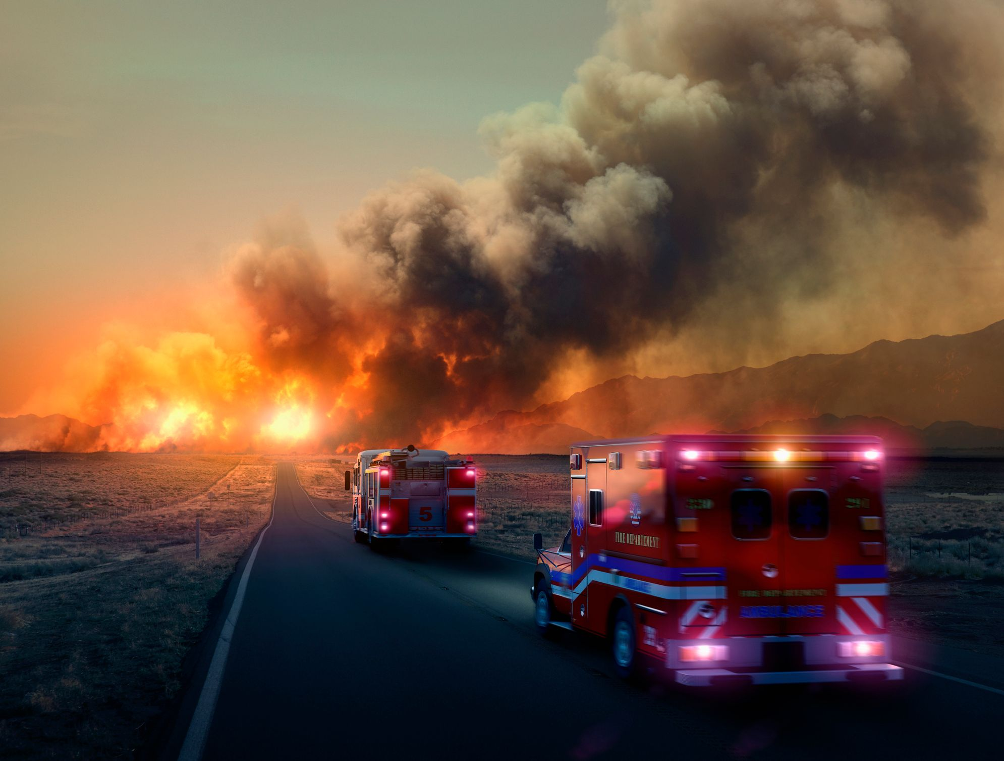 Ambulances going toward a fire in the woods. | Photo: Getty Images