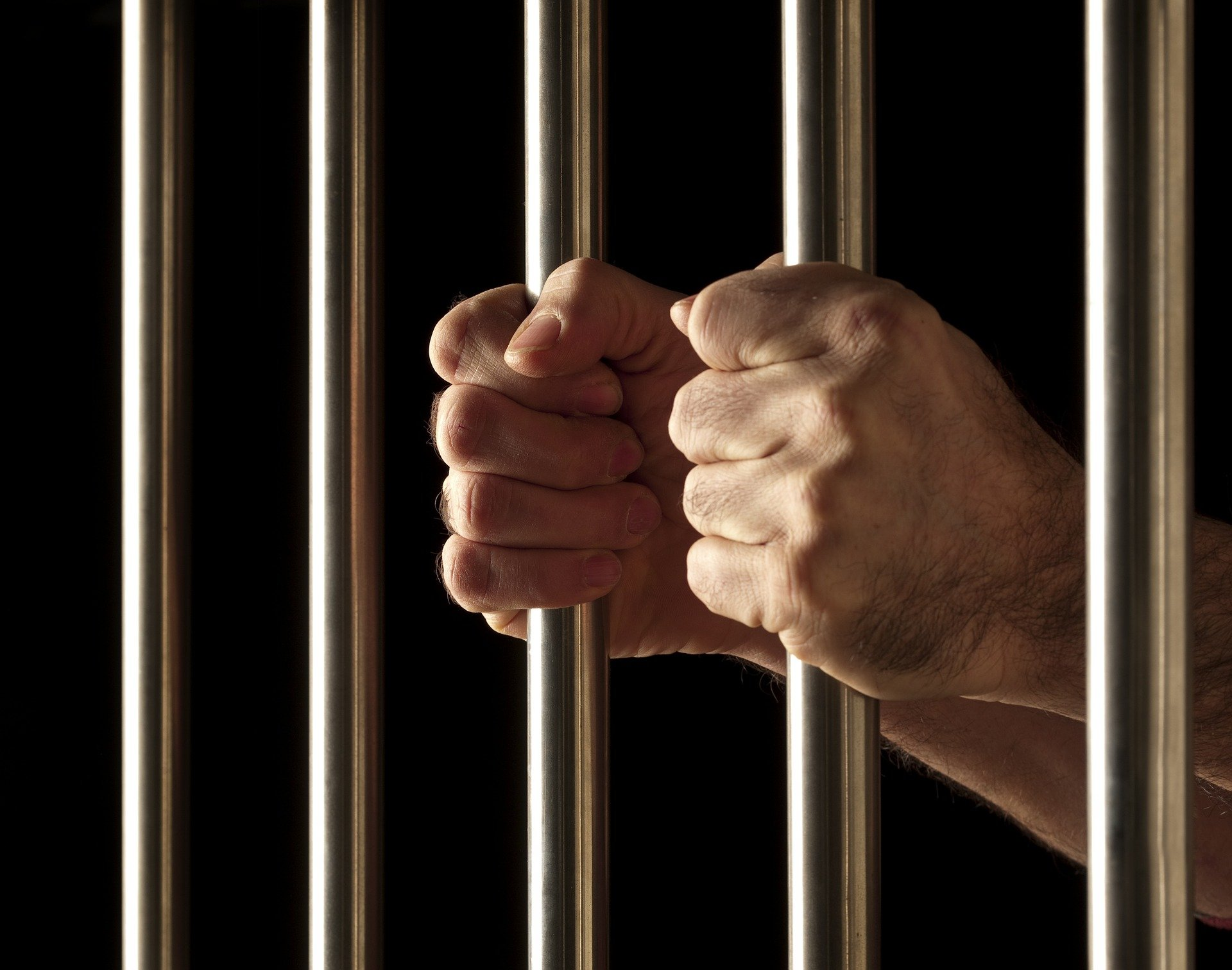 Pictured - A man behind jail cells   Source: Pixabay