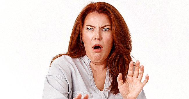 A woman looks shocked at the camera.   Source: Shutterstock