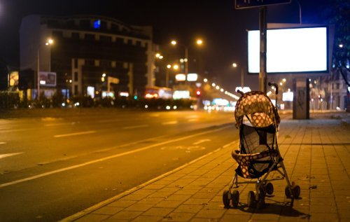 Abandoned baby stroller at night. | Source: Shutterstock