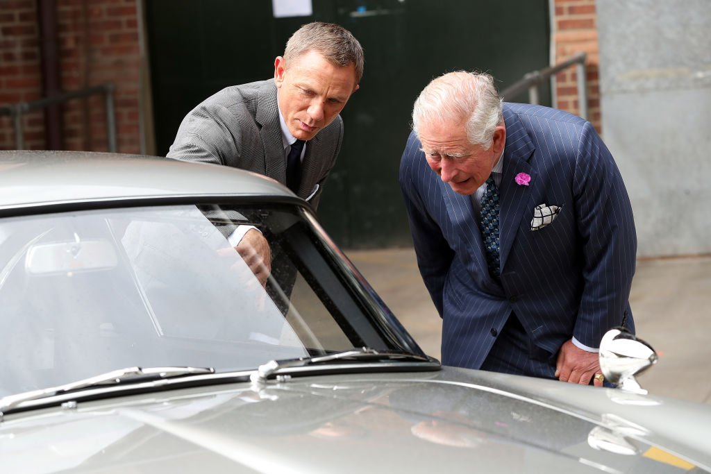 "Prince Charles talks to Daniel Craig during a tour of the 25th ""James Bond"" film set at Pinewood Studios on June 20, 2019 