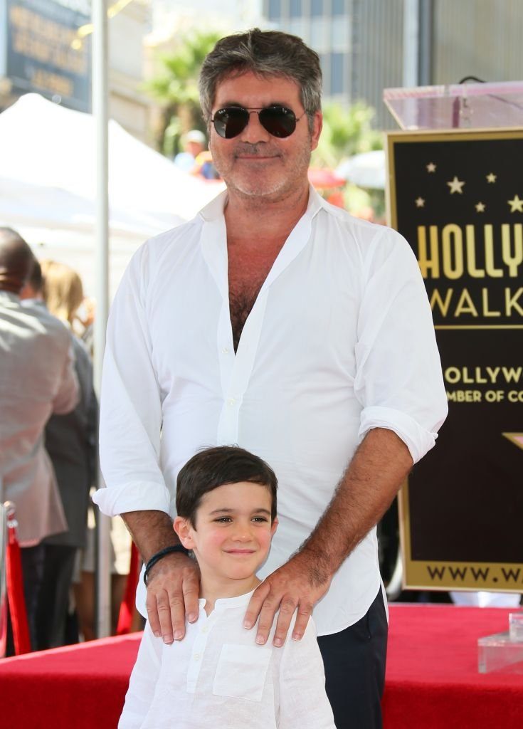 Simon and Eric Cowell at the ceremony honoring Simon Cowell with a Star on The Hollywood Walk of Fame on August 22, 2018, in Hollywood   Photo: Getty Images