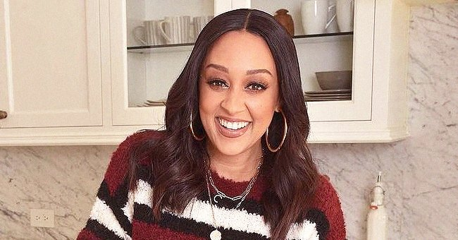 Tia Mowry's Kids Cree & Cairo Open Christmas Presents in Cute Matching Outfits with Their Dad