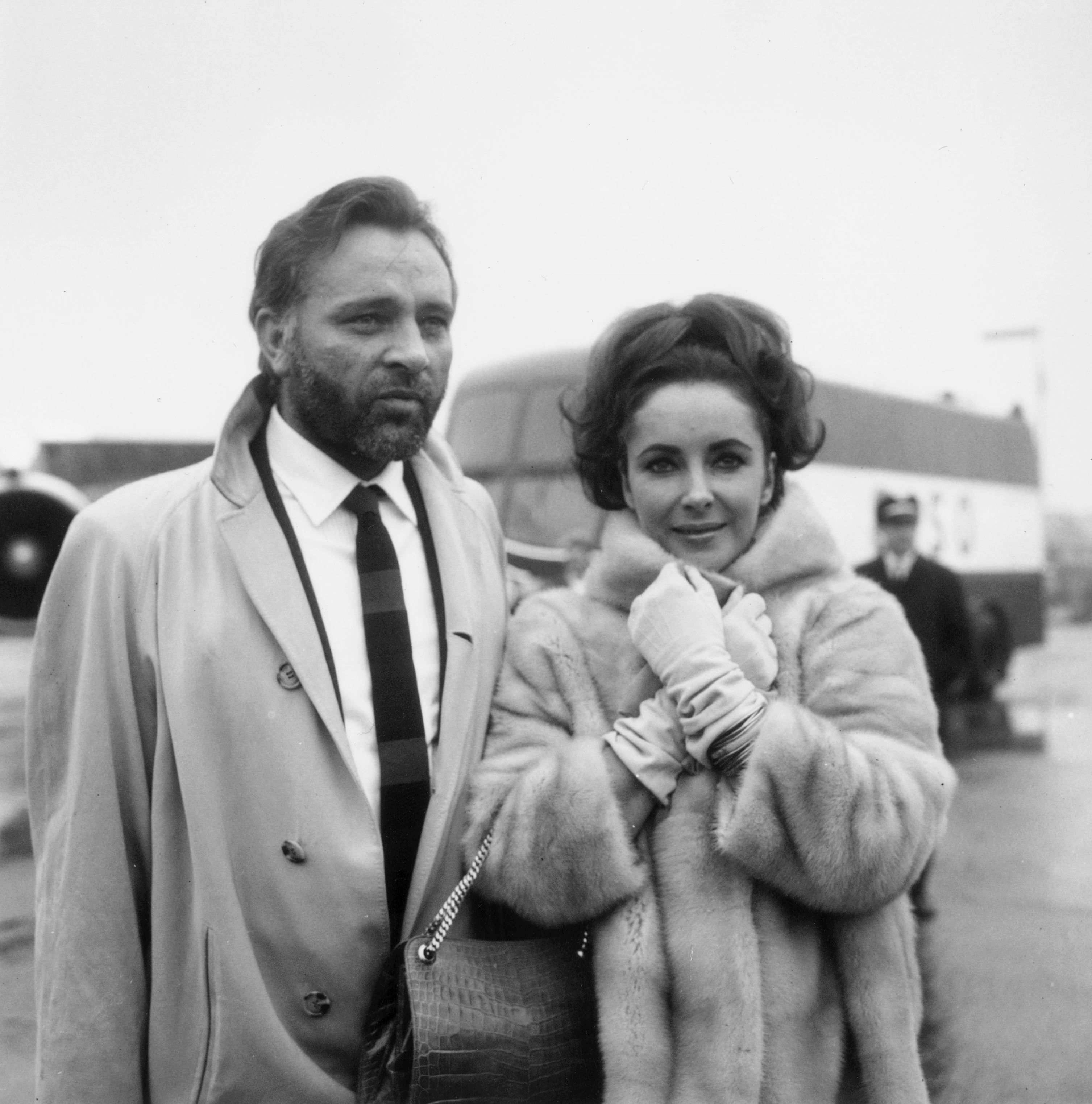 Richard Burton and Elizabeth Taylor at London Airport. February 1, 1966   Photo: GettyImages
