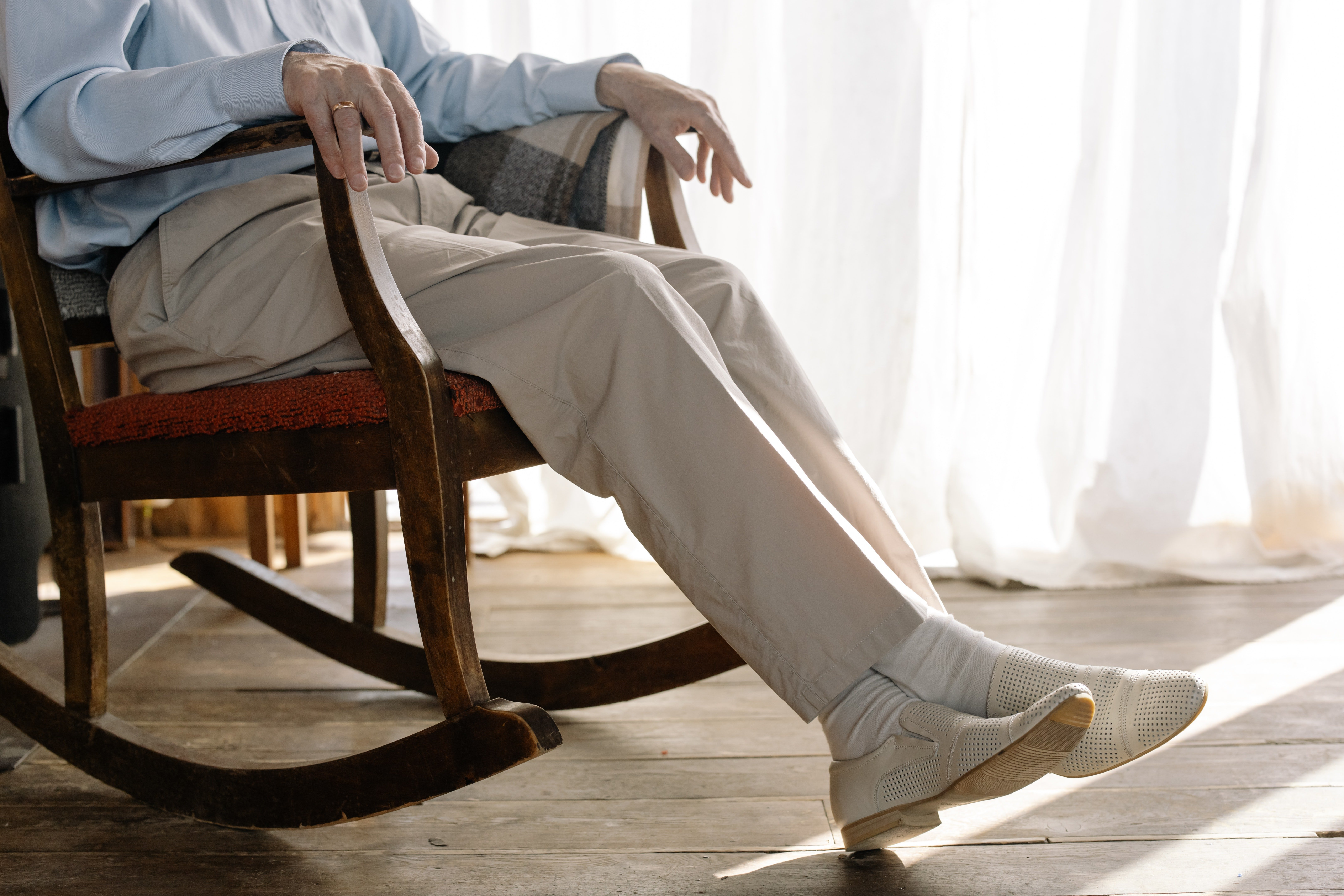 Pictured - A male individual on a rocking chair | Source: Pexels