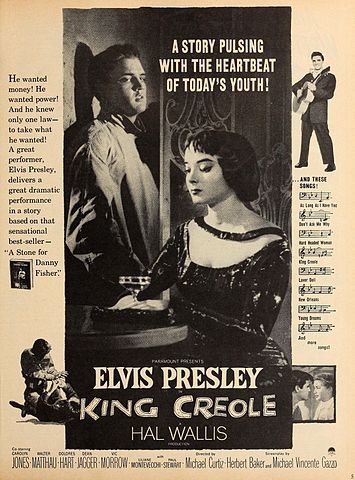 "Advertisement for ""King Creole"" starring Carolyn Jones and Elvis Presley. 