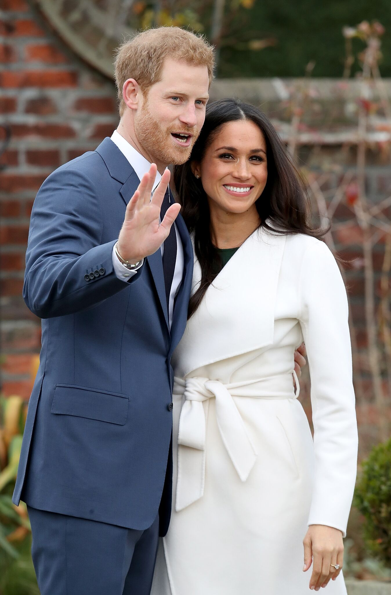 Prince Harry and actress Meghan Markle during an official photocall to announce their engagement at The Sunken Gardens at Kensington Palace | Getty Images