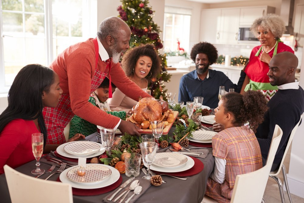 A family having a good time during Christmas. | Photo: Shutterstock