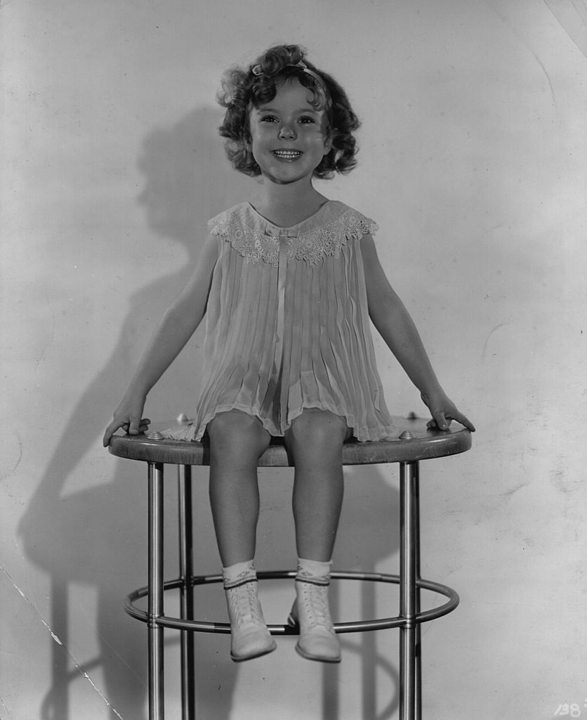 Shirley Temple smiles brightly at the camera | Getty Images / Global Images Ukraine
