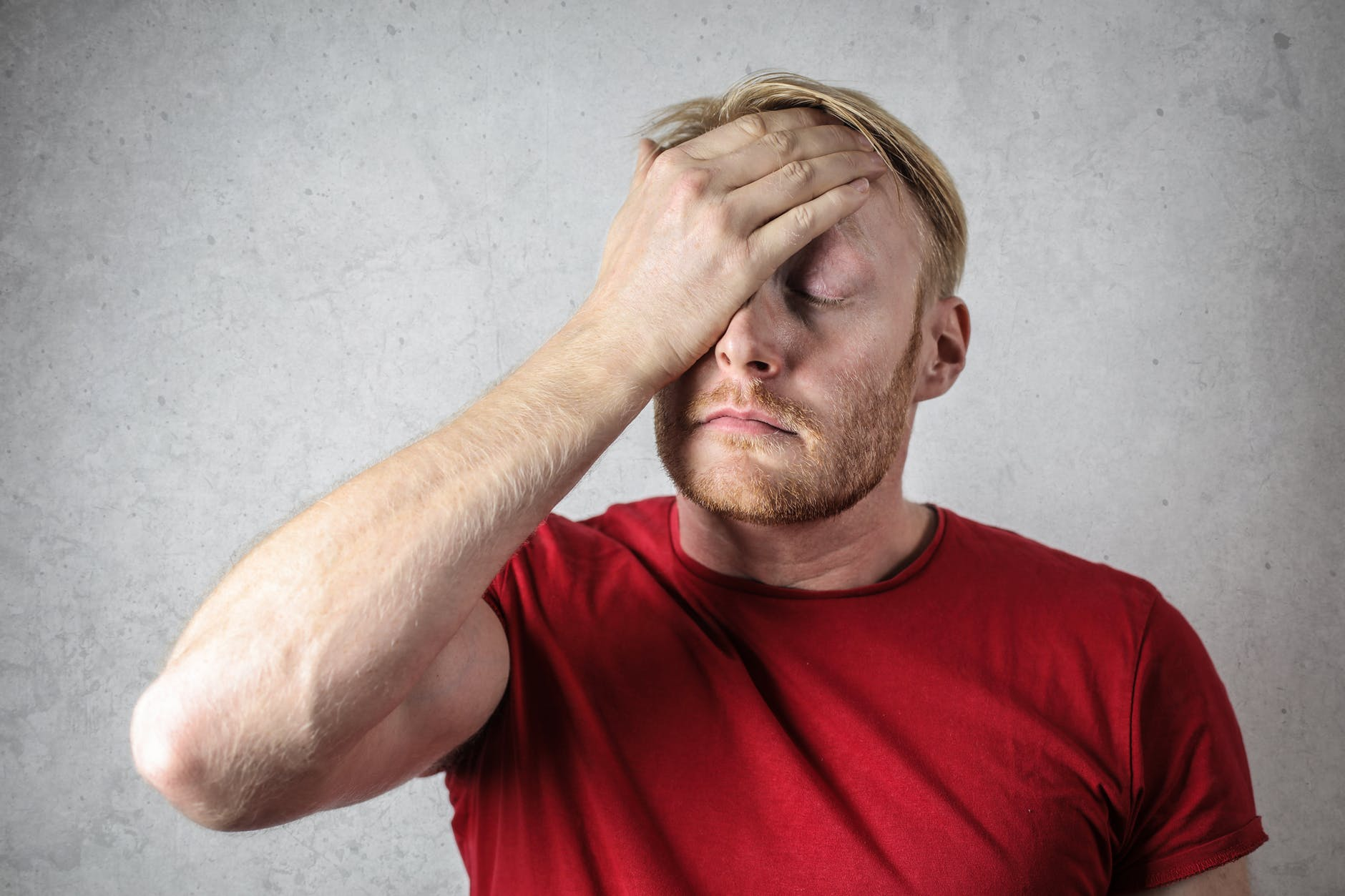 Man with hand to his forehead in frustration | Source: Pexels