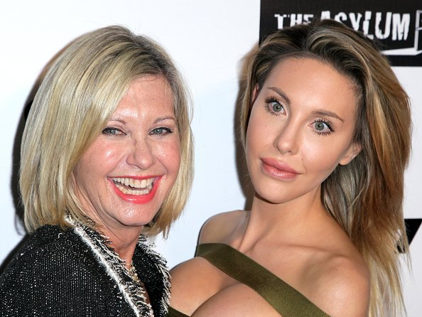 "Singer Olivia Newton-John and her daughter Chloe Lattanzi on the red carpet for the Premiere of Syfy's ""Dead 7"" at Harmony Gold on April 1, 2016 in Los Angeles, California 