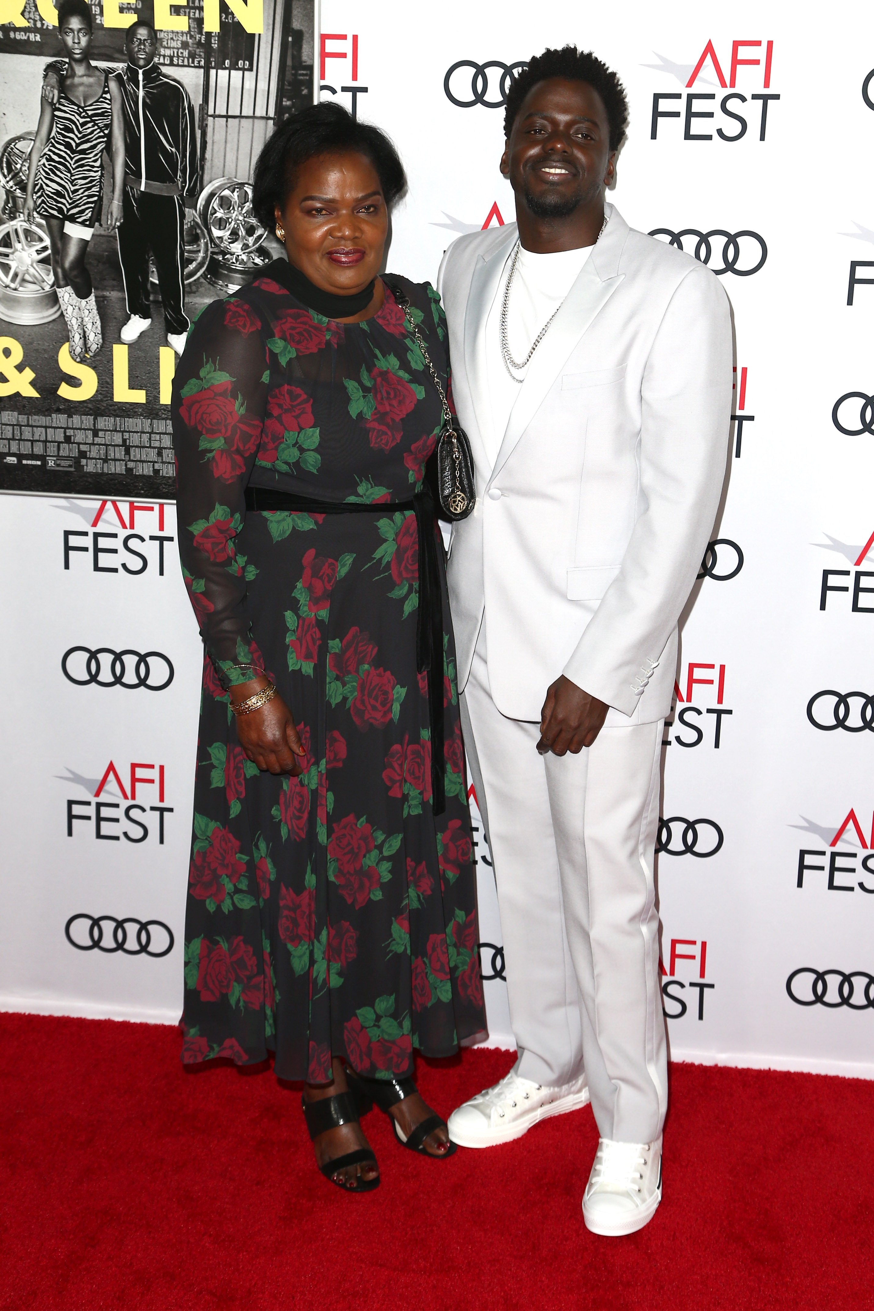 """Daniel Kayuula and his mother, Damalie Namusoke, pictured at  AFI FEST 2019 Presented By Audi premiere of """"Queen & Slim,"""" 2019. 