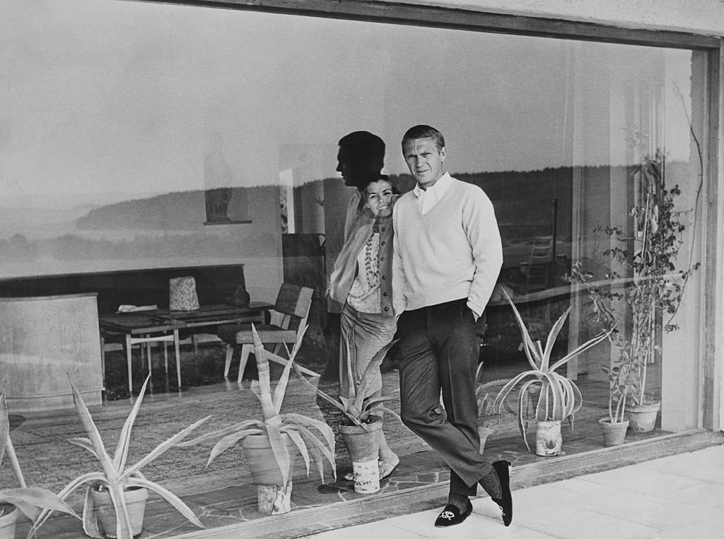 American actor Steve McQueen (1930 - 1980) and his first wife, actress Neile Adams, separated by a windowpane, circa 1965.   Source: Getty Images