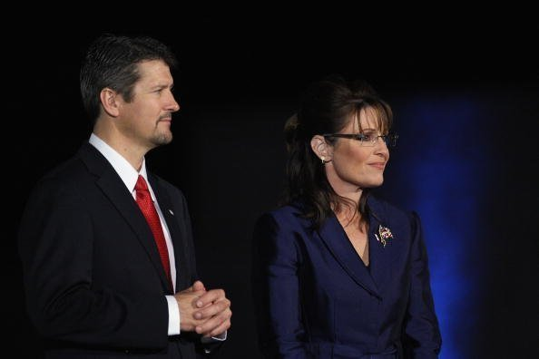 Sarah Palin and husband Todd Palin stand on stage during the election night rally at the Arizona Biltmore Resort & Spa on November 4, 2008 in Phoenix, Arizona | Photo: Getty Images