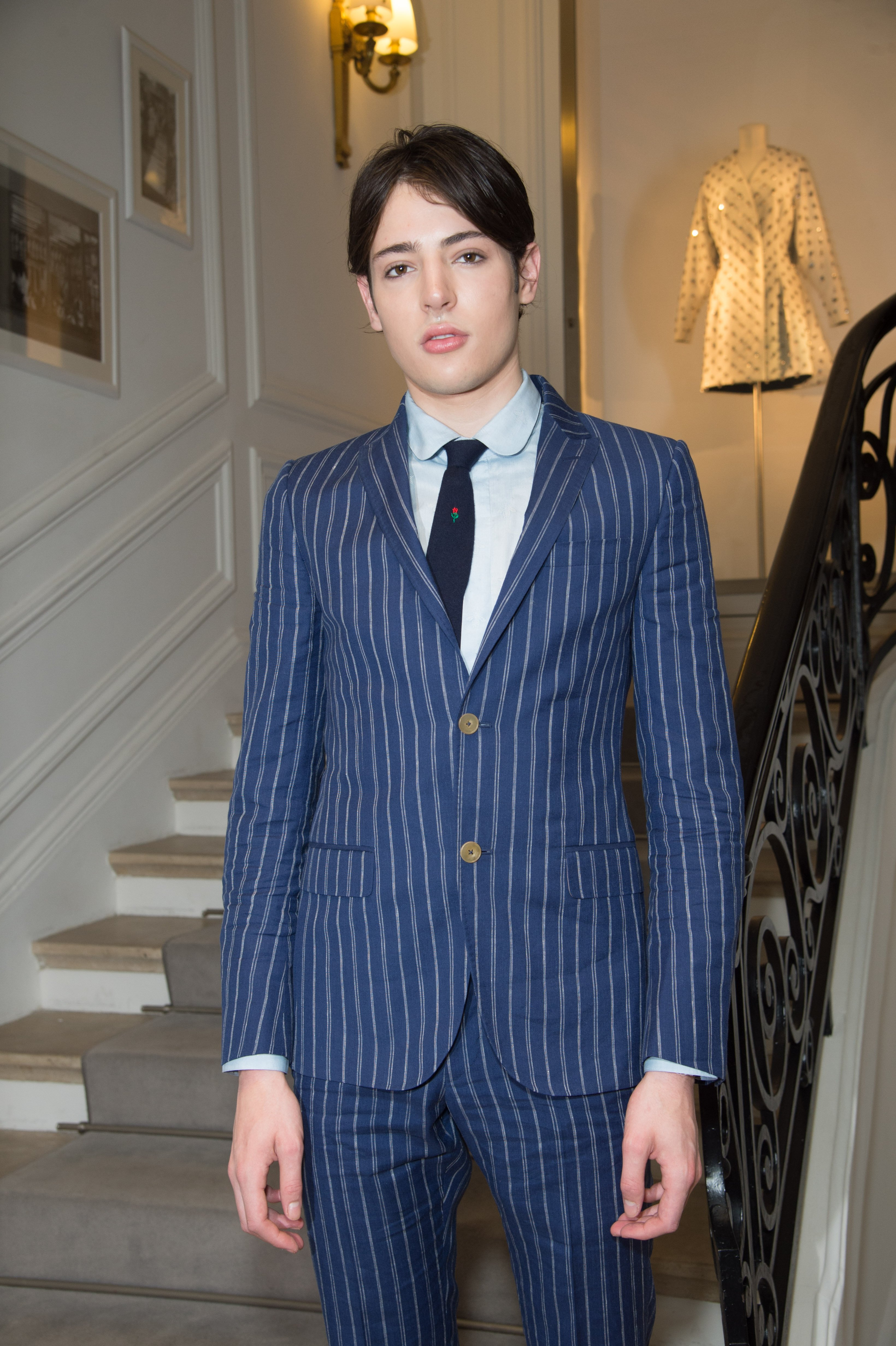 US socialite and model Harry Brant poses before Christian Dior 2016-2017 fall/winter Haute Couture collection fashion show on July 4, 2016 | Photo: Getty Images