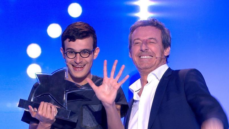 La photo de Paul avec Jean-Luc Reichmann | Source: Twitter TV magazine