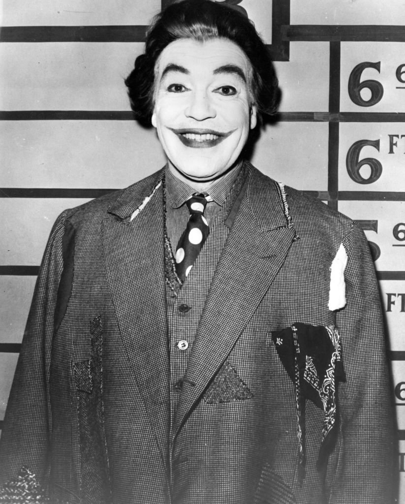 Cesar Romero as The Joker, a devious villain in the 'Batman' television series. | Getty Images