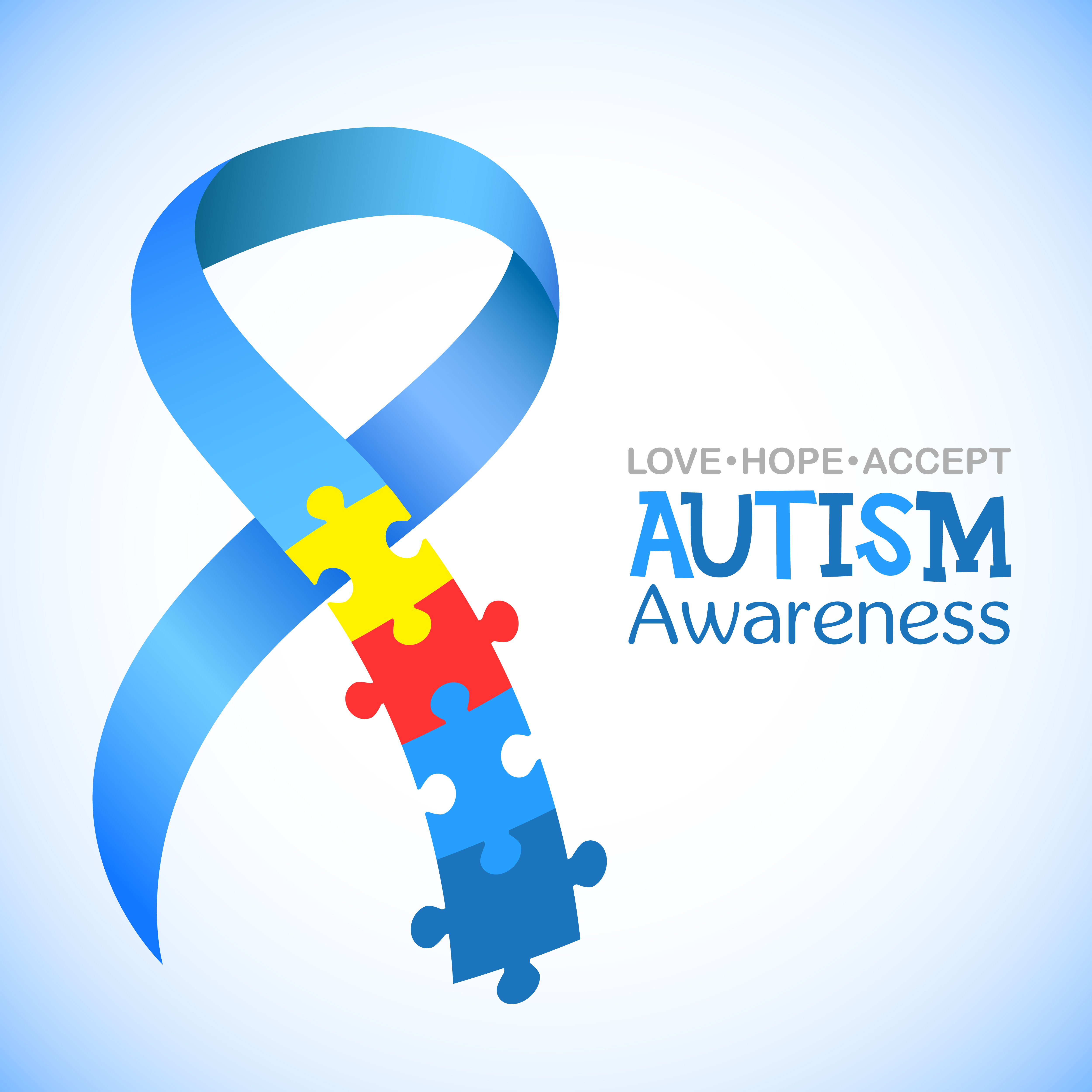 Blue ribbon with colourful puzzles vector background; a symbol of autism. | Source: Shutterstock