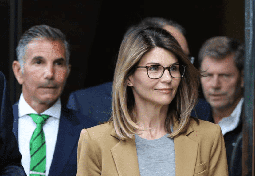 For their role in the national college admission scandal, Lori Loughlin and her husband, Mossimo Giannulli leave the John Joseph Moakley United States Courthouse, on April 3, 2019, Boston | Source: Pat Greenhouse/The Boston Globe via Getty Images