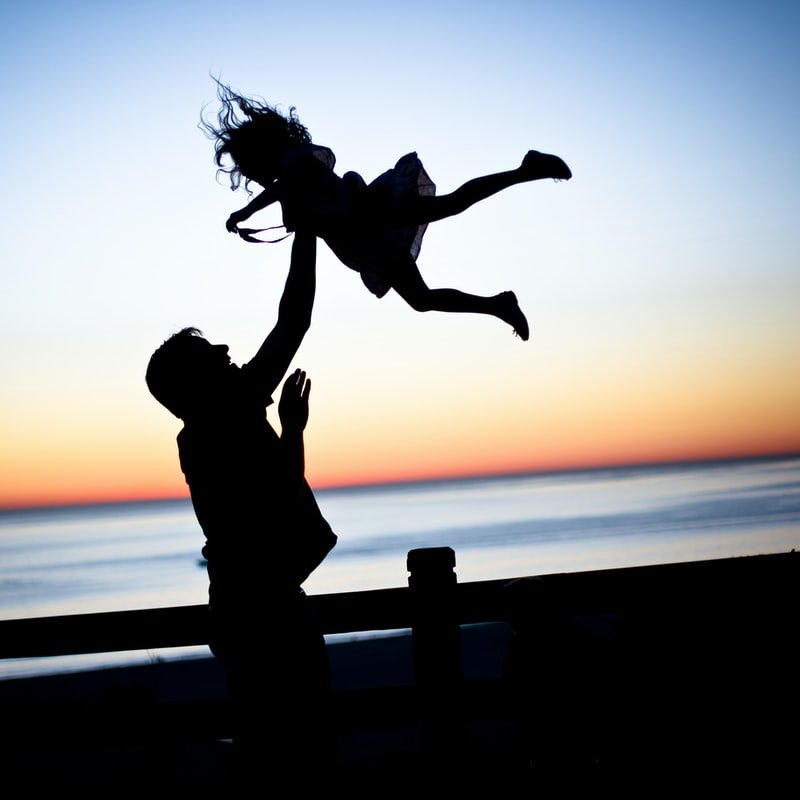 Safe in her father's hands | Source: Unsplash