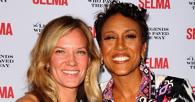 "Amber Laign and Robin Roberts arrive on the red carpet for the ""Selma and the Legends Who Paved the Way"" gala on December 6, 2014 