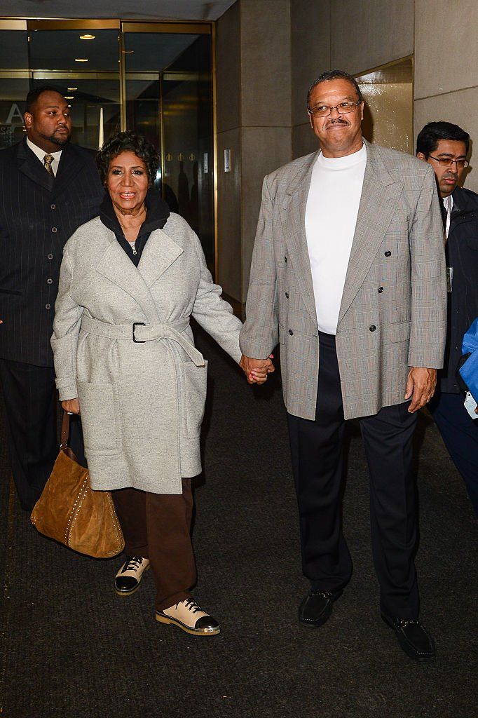 """Aretha Franklin and Willie Wilkerson leaving the """"Today"""" show in October 2014. 