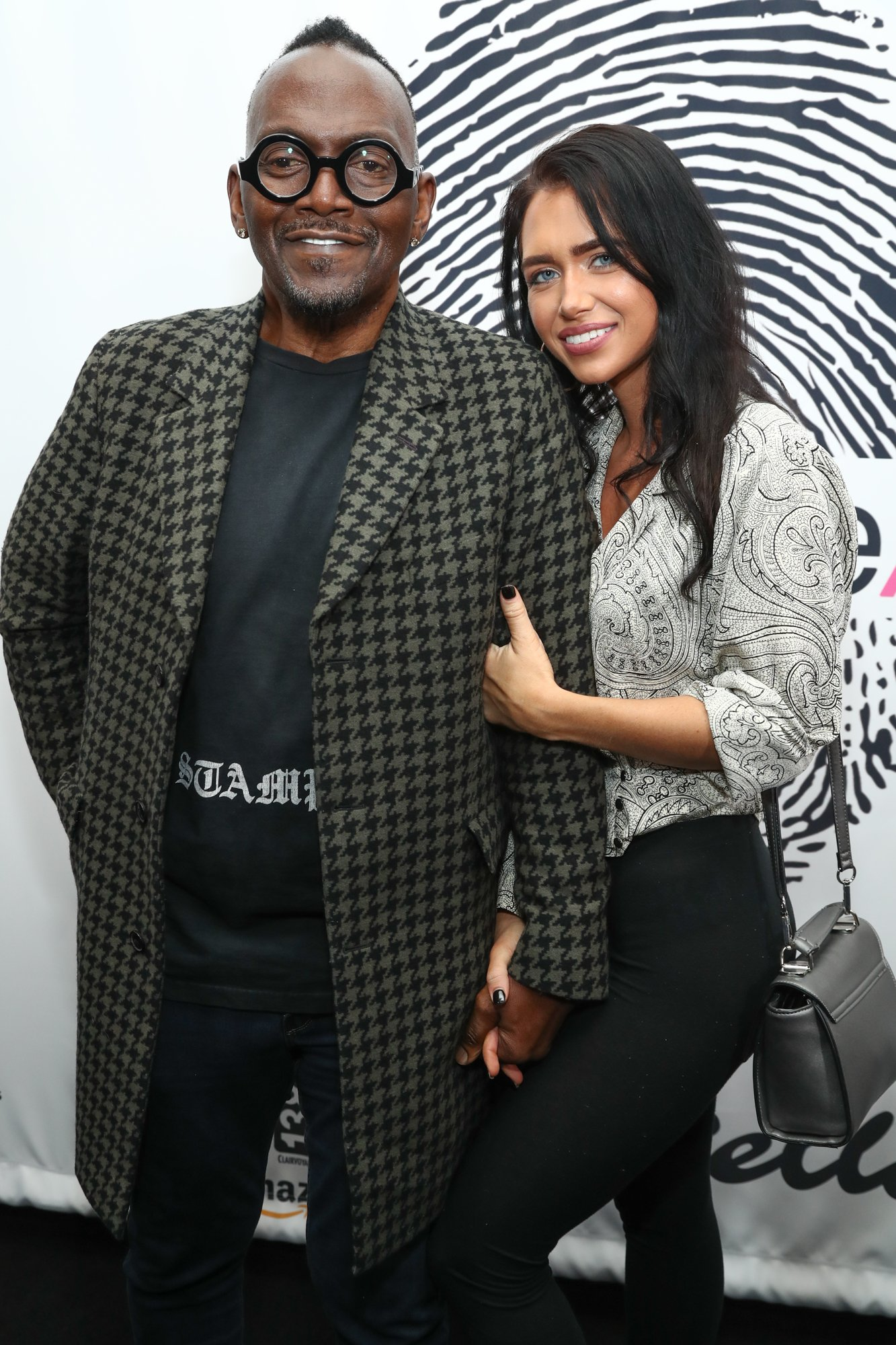 Randy Jackson and Simone pose on the red carpet of The Cool HeART Gallery in Los Angeles on Jan 17. | Photo: Getty Images.