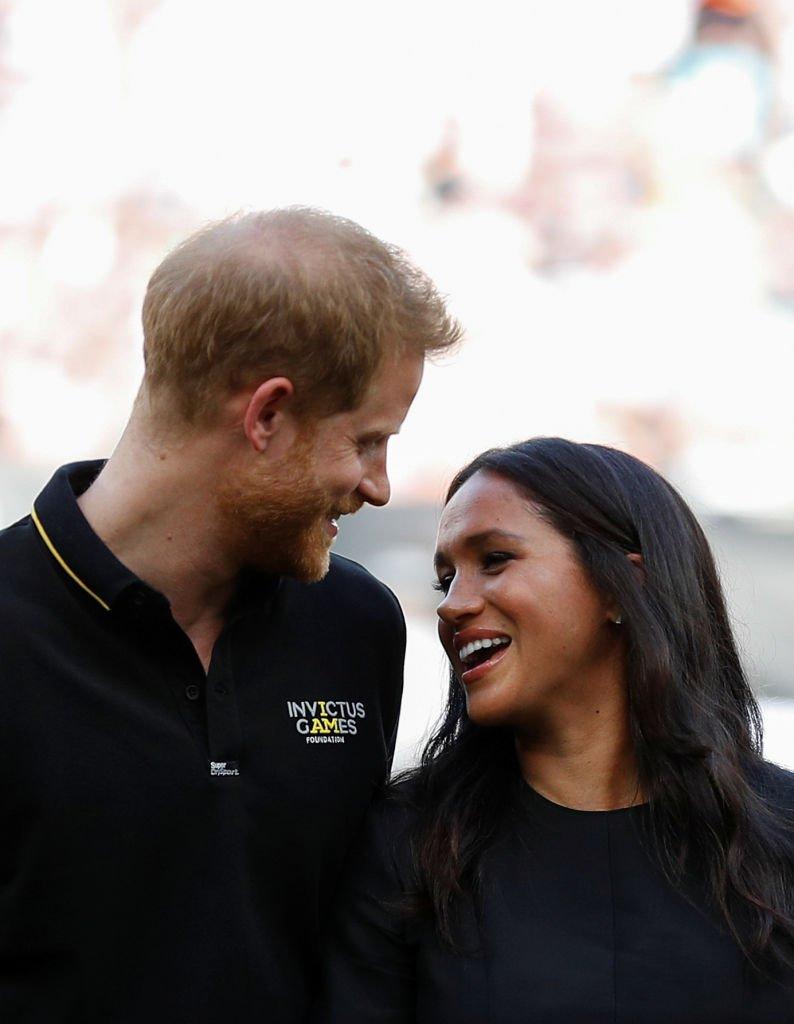 Le prince Harry et son épouse Meghan au London Stadium  Photo : Getty Images