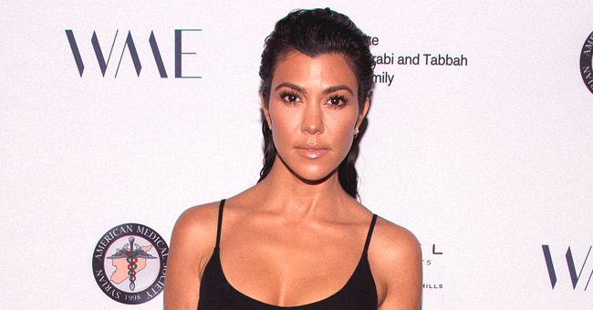 Kourtney Kardashian Puts Her Legs on Display in Mini-Dress and Knee-High Stockings