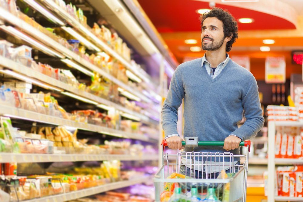 Father shopping in the supermarket. | Source: Shutterstock.com