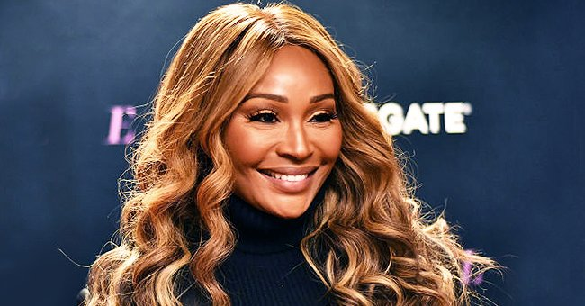 RHOA Star Cynthia Bailey Displays Her Fit Legs in a Snake-Print Swimsuit — See Her Look