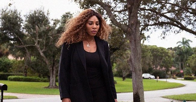Serena Williams Rocks Black Outfit & Pink Shoes from Her Collection While Walking with a Dog