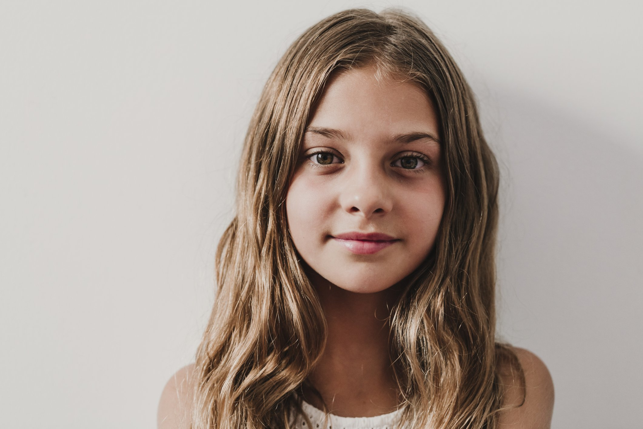 A portrait of a young girl smiling.   Photo: Getty Images