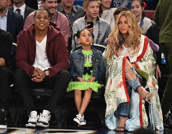 Jay Z, Blue Ivy Carter and Beyonce Knowles attend the 66th NBA All-Star Game at Smoothie King Center in New Orleans, Louisiana. | Photo: Getty Images