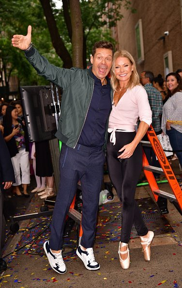 "Kelly Ripa and Ryan Seacrest on set of ABC's ""Live with Kelly and Ryan"" on the streets of Manhattan on September 10, 2019 in New York City. 