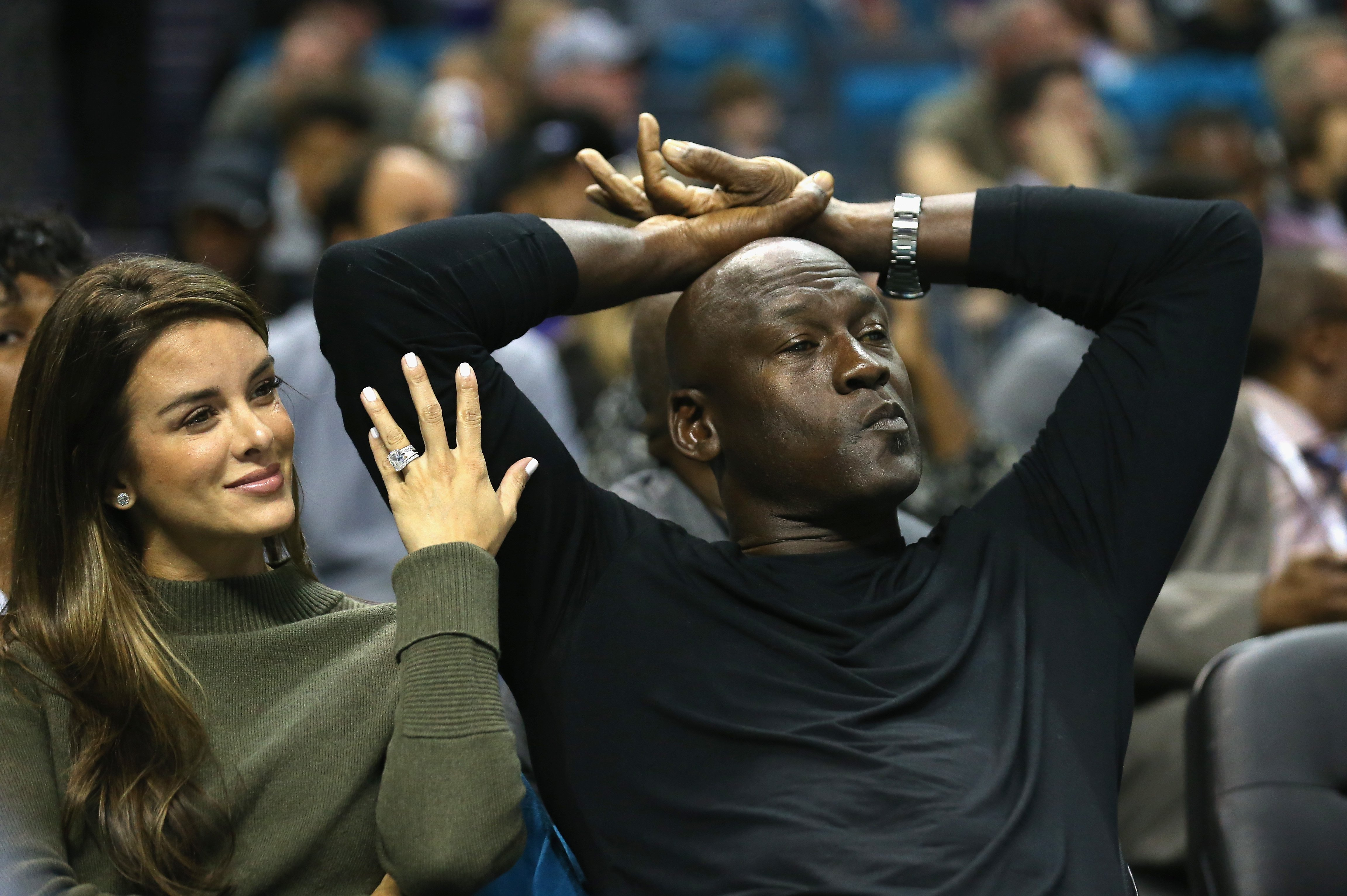 Yvette Prieto and her husband and owner of the Charlotte Hornets, Michael Jordan, watch on during their game against the Atlanta Hawks at Time Warner Cable Arena on November 1, 2015  | Photo: GettyImages