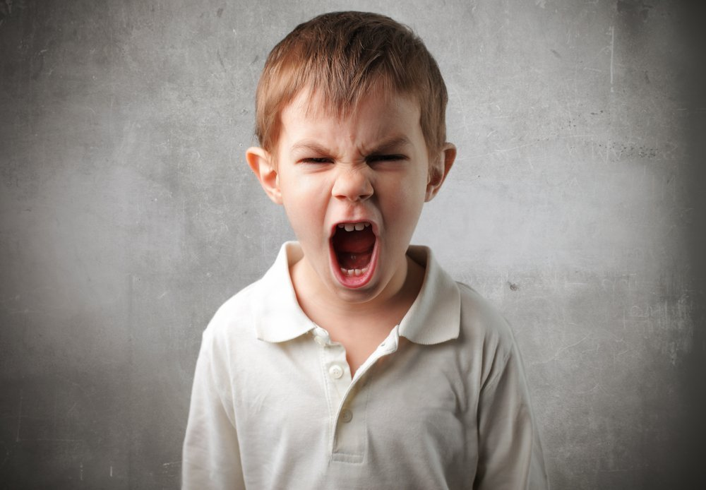 A child with an angry expression. | Photo: Shutterstock