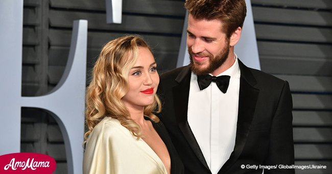 Miley Cyrus and Liam Hemsworth are seen holding hands while enjoying a romantic dinner date
