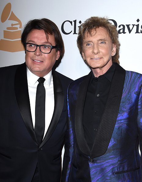 Garry Kief and singer Barry Manilow attend the 2016 Pre-GRAMMY Gala and Salute to Industry Icons honoring Irving Azoff at The Beverly Hilton Hotel | Photo: Getty Images