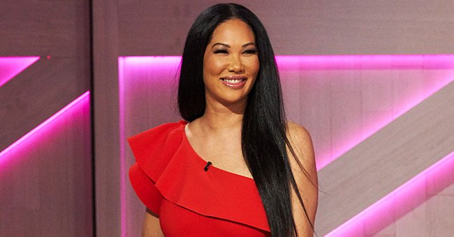 Kimora Lee Simmons Shares Cool Pic with a Cute Fan Posing in Twinning Black Hoodie & Boots